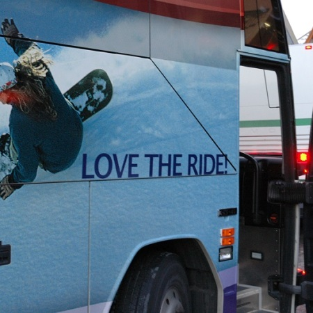 """Love the Ride!"" painted on the side of a snowbus in Whistler, BC."