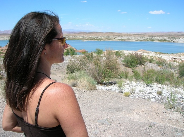 A woman looks out over the Colorado river.