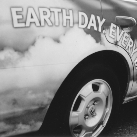 "Detail of a car painted with the slogan, ""Earth Day, Every Day."""