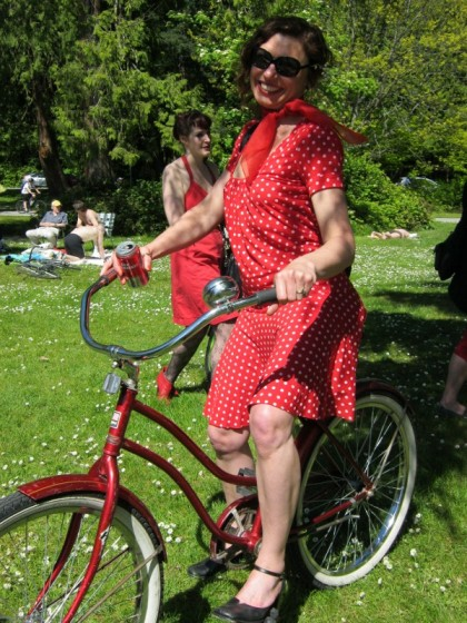 Joye on red bicycle in Vancouver Velo Vixens vintage cruiser bicycle ride