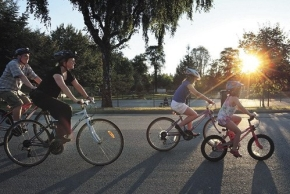A family cycling at dusk in Vancouver, Canada.