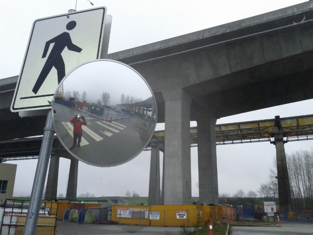 Pedestrian crossing sign under Port Mann Bridge