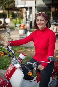 Vancouver writer Ulrike Rodrigues on a Symba Honda Cub motorcycle