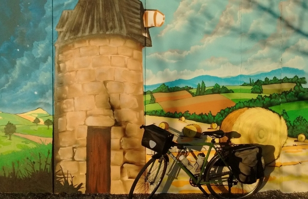 A bicycle in front of a mural in Mural in Serignac-Peboudou, France