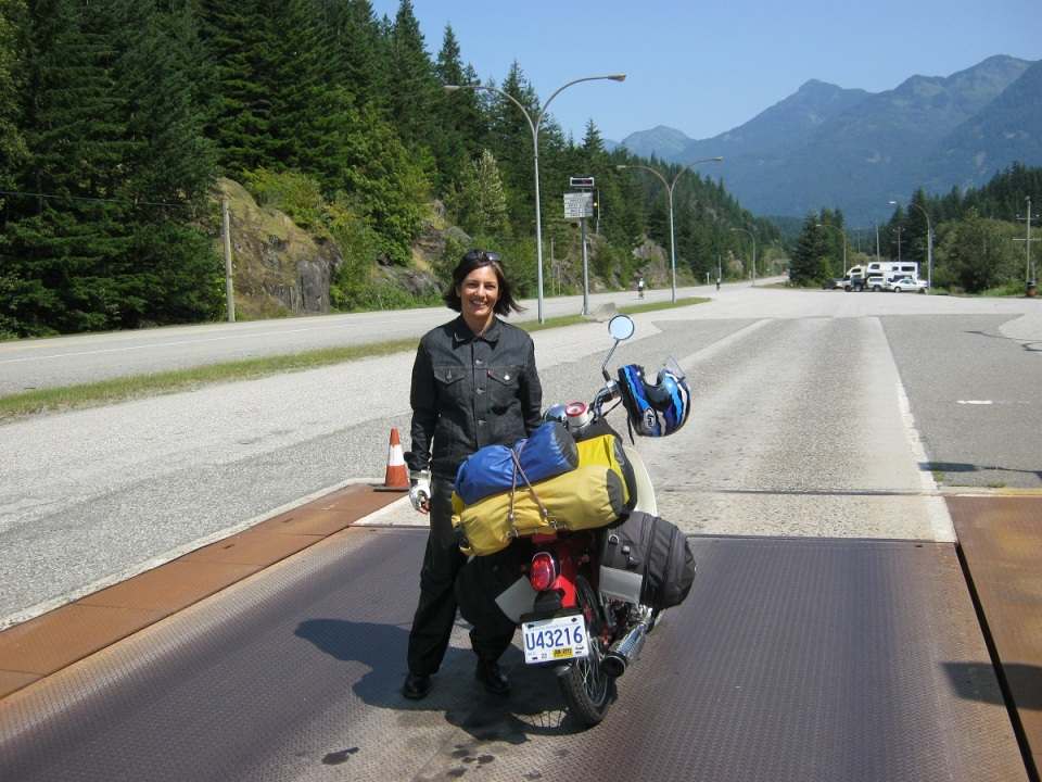 Ulrike rodrigues with symba honda cub on bc highway scale