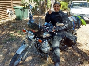 Ulrike gives a thumbs up on a Honda Rebel motorcycle loaded with camping gear in McLaren Vale, Australia
