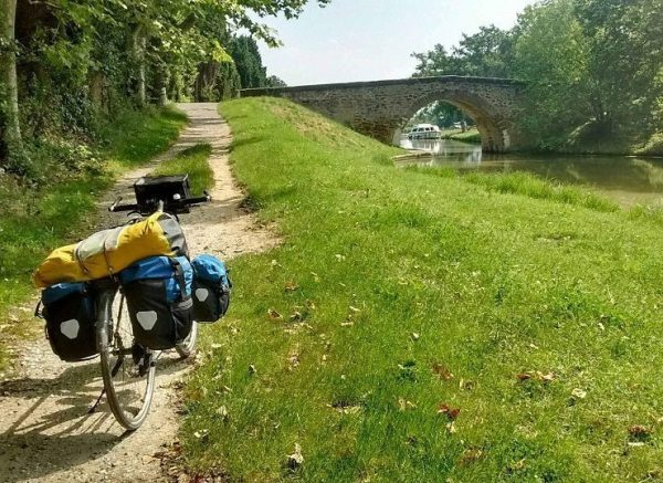 A touring bicycle next to the Canal du Midi near Carcassone, France.