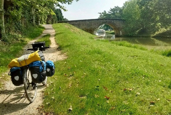 Touring bicycle on a dirt path next to the Canal du Midi, France.