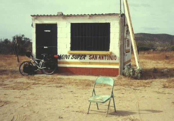 Colourful, abandoned shack with chair in front in Baja Mexico