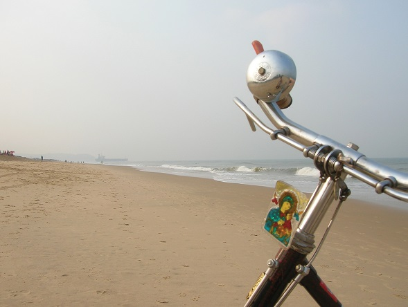 Detail of an Indian-style bicycle on a sand beach in Goa, India