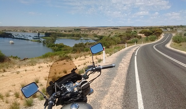 A Honda Rebel on a winding road that follows the Murray River in Australia.